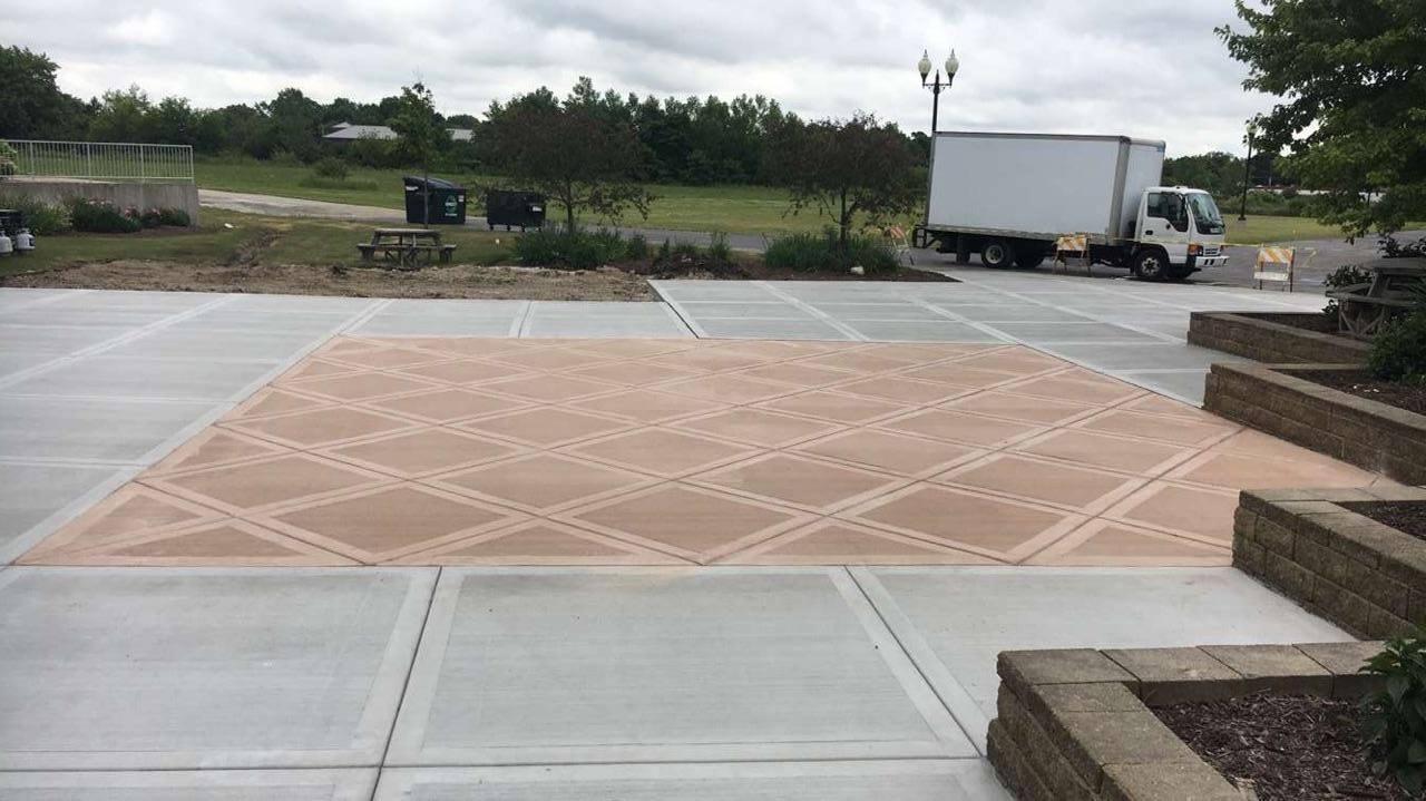 Colored concrete patio with California finish